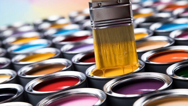 Colorful cans of paint from Marketplace Paints Aiken South Carolina
