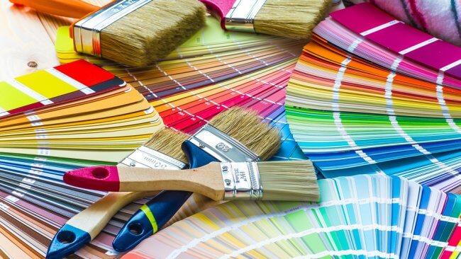 Pantone sample colors spread across a table