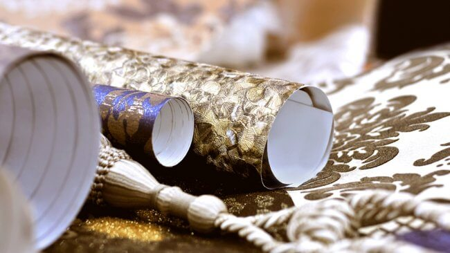 Rolls of gold and white wallpaper
