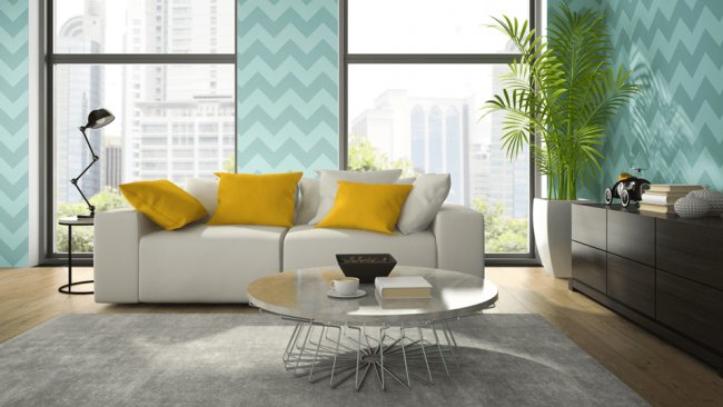 Contemporary living room with white couch large windows and turquoise wall paper