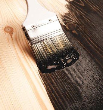 Brushing woods stain on wood