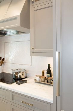 Kitchen cabinet painted tan with Benjamin Moore Paints