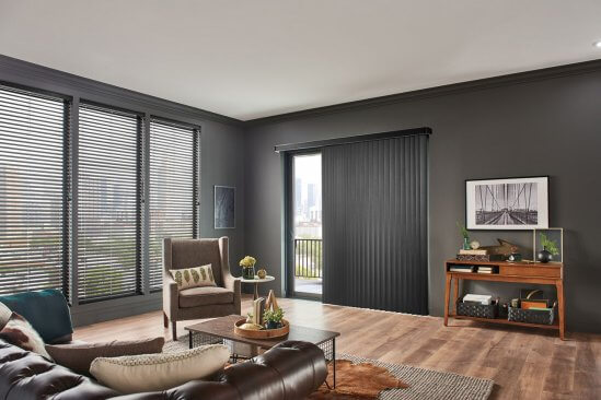 Livingroom with woods floors, brown walls and Graber blinds