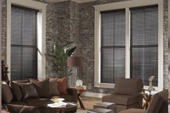 Pinnacle Blinds in a living room with wood floors and brick walls