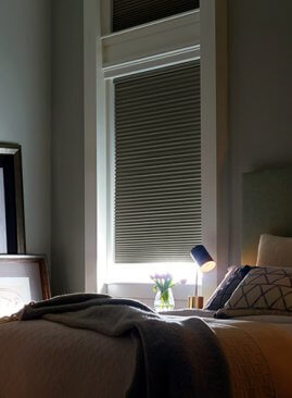 Hunter Douglas Blinds in an olive colored bedroom