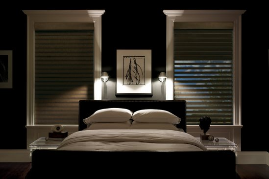 Two windows with Blinds in a dark tones bedroom