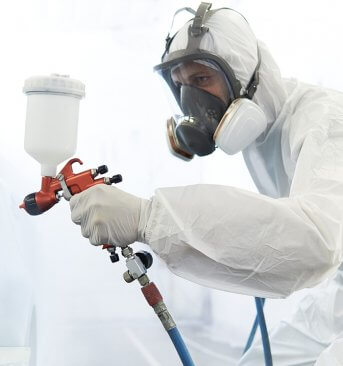 Professional painter using an airless sprayer