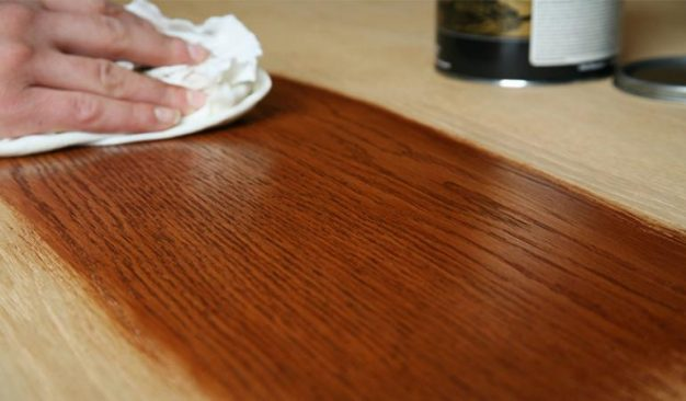 Old Masters Gel Stain being wiped on wood